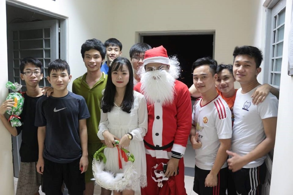 Santa Claus and Snow princess taking picture with students